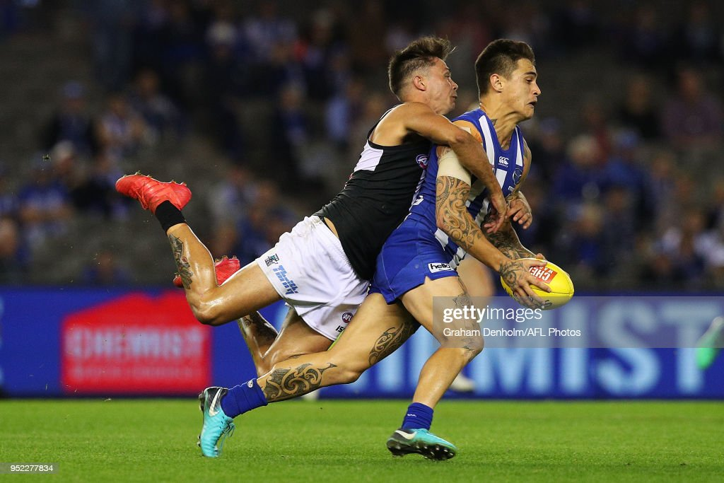 Marley Williams of the Kangaroos (R) is tackled during the round six AFL match between the North Melbourne Kangaroos and Port Adelaide Power at Etihad Stadium on April 28, 2018 in Melbourne, Australia.