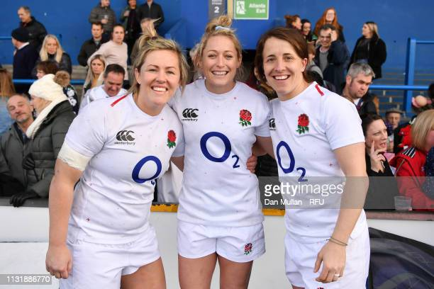 Marlie Packer Natasha Hunt and Katy DaleyMcLean of England pose for a photo following victory during the Women's Six Nations match between Wales...
