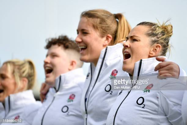 Marlie Packer of England and team mates sing the national anthems prior to the Womens Six Nations match between England and Italy at Sandy Park on...