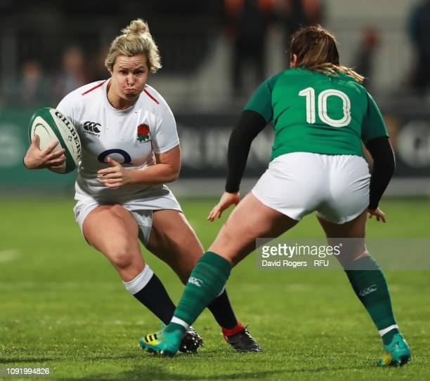 Marlie Packer of England is faced by Nicole Fowley of Ireland during the Women's Six Nations match between Ireland and England at Energia Park...
