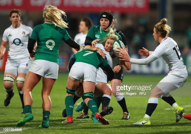 Marlie Packer of England is tackled by Claire Molloy of Ireland during the Women's Six Nations match between Ireland and England at Energia Park...