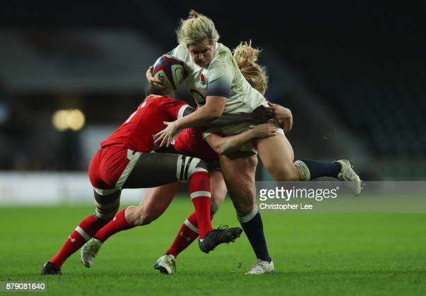 Marlie Packer of England is tackled by Emmanuela Jada of Canada and Emily Belchos of Canada during the Old Mutual Wealth Series match between England...