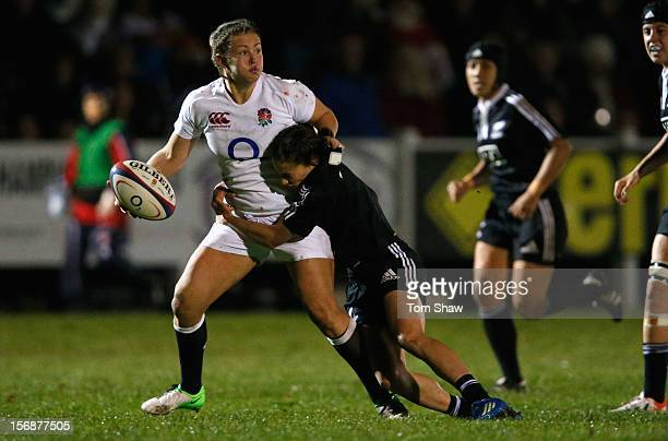 Marlie Packer of England is tackled during the England Women v New Zealand Womens match at Esher Rugby Club on November 23 2012 in Esher England