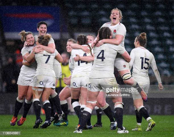 Marlie Packer of England jumps into the arms of Poppy Cleall after winning the Grand Slam during the Women's Six Nations match between England Women...