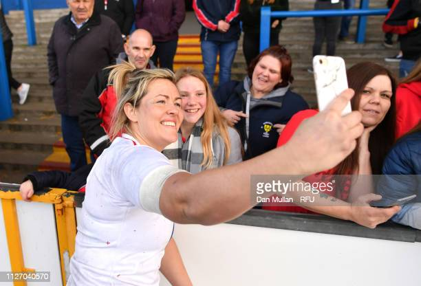 Marlie Packer of England poses for a photograph with fans during the Wales Women and England Women match in the Women's Six Nations at Cardiff Arms...
