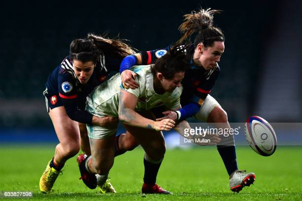 Marlie Packer of England tackled by Elodie Guiglion of France and Jade Le Pesq of France during the Women's Six Nations match between England and...