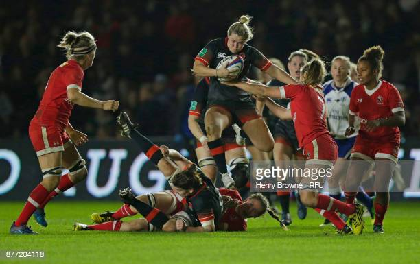 Marlie Packer of England tackled by Sara Svoboda of Canada during the Old Mutual Wealth Series match between England Women and Canada Women at...
