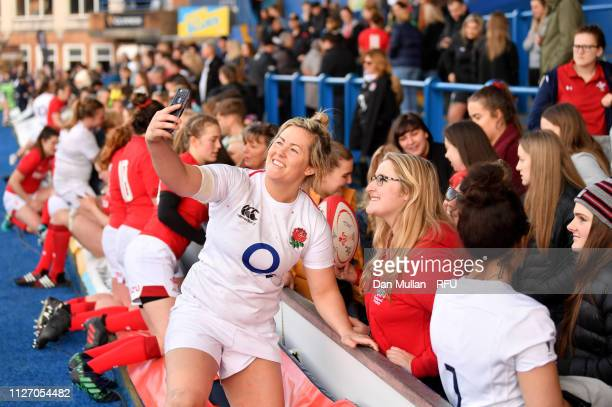 Marlie Packer of England takes a selfie with fans after the Wales Women and England Women match in the Women's Six Nations at Cardiff Arms Park on...