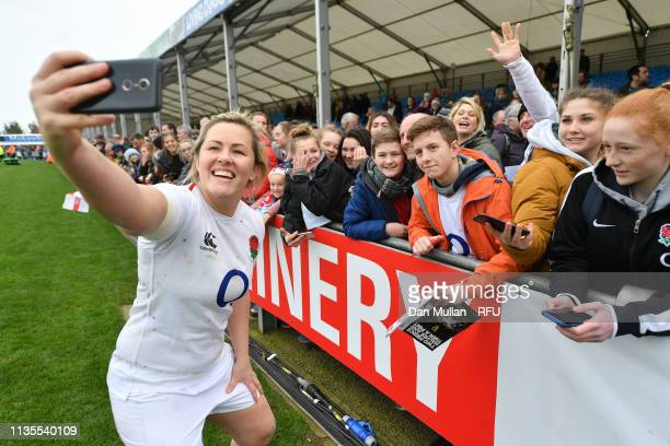 Marlie Packer of England takes a selfie with fans following the Womens Six Nations match between England and Italy at Sandy Park on March 09 2019 in...