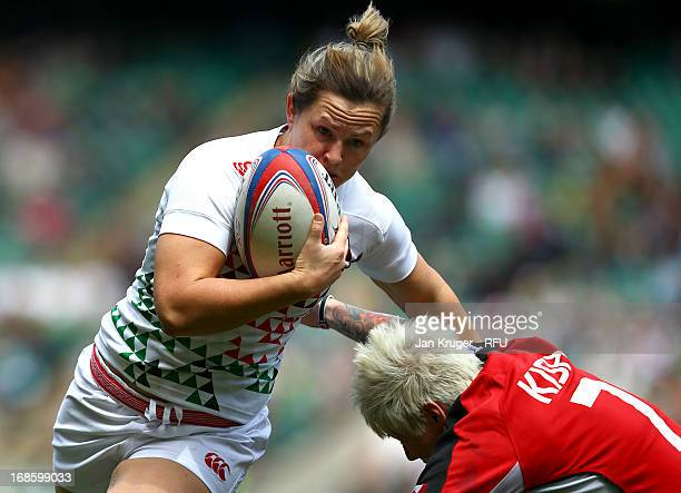 Marlie Packer of England Women holds off Jennifer Kish of Canada in the Women's Cup Semi Final match during day two of the Marriott London Sevens at...