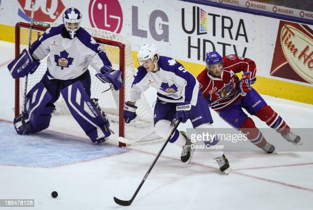 Marlies defenceman Korbinian Holzer heads up ice from behind his own net with Gabriel Dumont right behind him The Toronto Marlies defeated the...