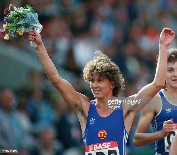 Marlies Goehr of German Democratic Republic celebrates after winning gold in the women's 4 x 100m relay during the European Athletic Championships at...