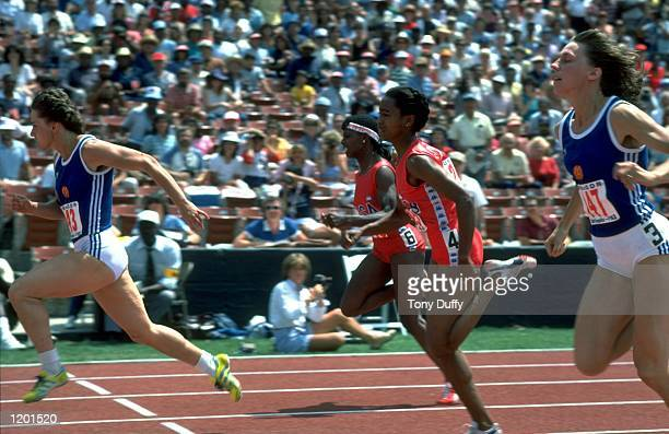 Marlies Gomr of East Germany leads from Evelyn Ashford of the USA and Marita Koch of East Germany during an event at the Coliseum Stadium in Los...