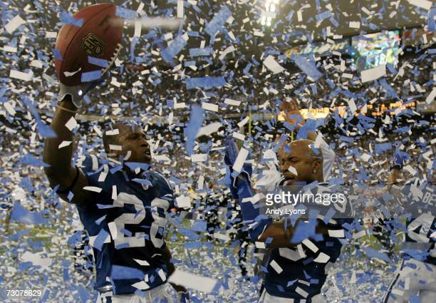 Marlin Jackson and Cato June of the Indianapolis Colts celebrate amongst confetti after their team defeated the New England Patriots 3834 in the AFC...