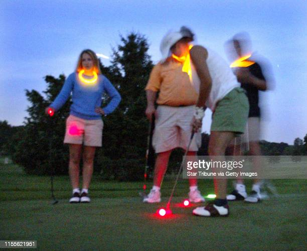 Marlin Levison - Strib 07/09/04 - Eagan - Golfers can now play golf after dark with the Glow Golf program being promoted at Parkview Golf Club in...