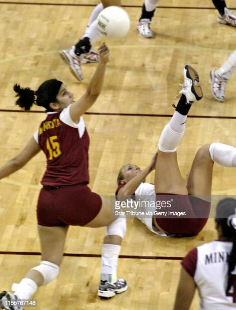 Marlin Levison Strib 12/11/04 Assign UM Gophers vs Ohio State IN THIS PHOTO Ohio State's Michaele Blackburn's spike was too much for Gophers Paula...