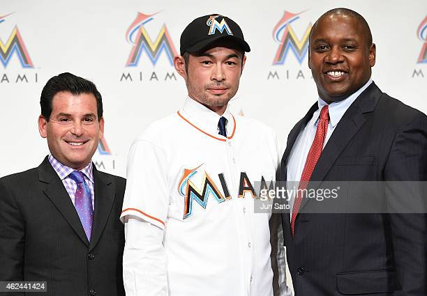 Marlines President of Baseball Operations Michael Hill Ichiro Suzuki and Miami Marlins president David Samson pose for a photograph during the press...