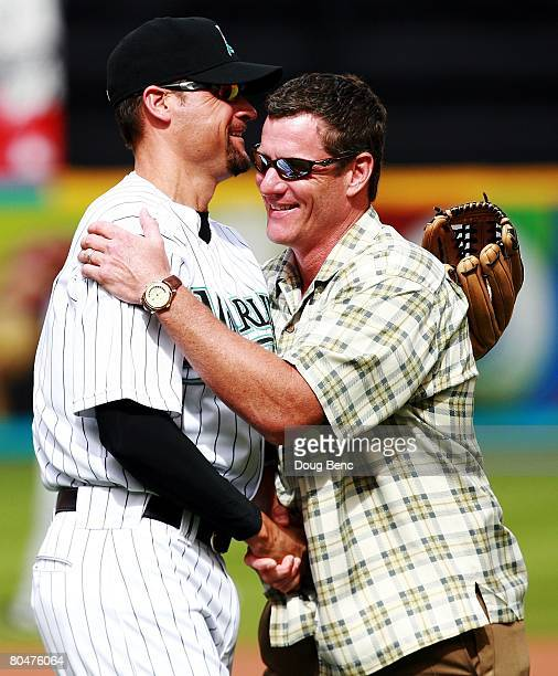 Marlins' coach Andy Fox congratulates Jeff Conine formerly of the Florida Marlins after throwing out the first pitch of the game against the New York...