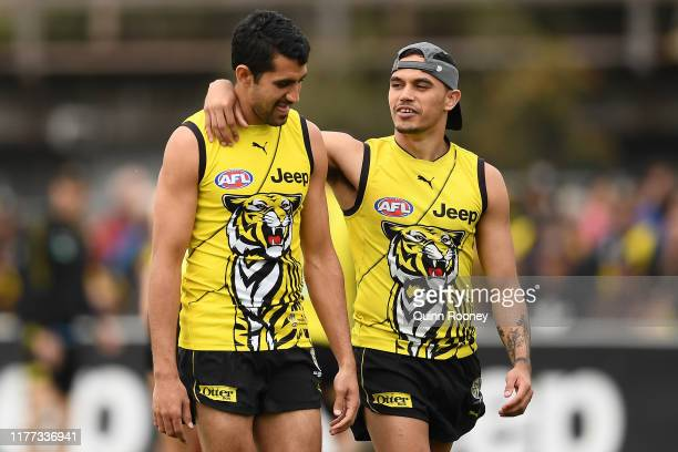 Marlion Pickett and Sydney Stack of the Tigers talk during a Richmond Tigers AFL training session at Punt Road Oval on September 27, 2019 in...