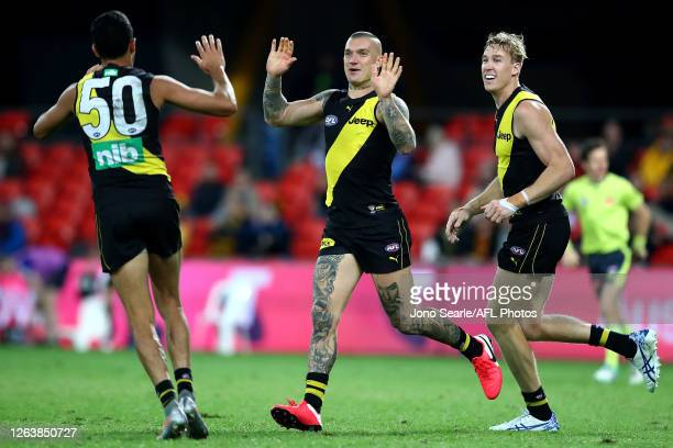 Marlion Pickett, Dustin Martin and Tom J. Lynch of the Tigers celebrate a Marlion Pickett goal during the round 10 AFL match between the Richmond...