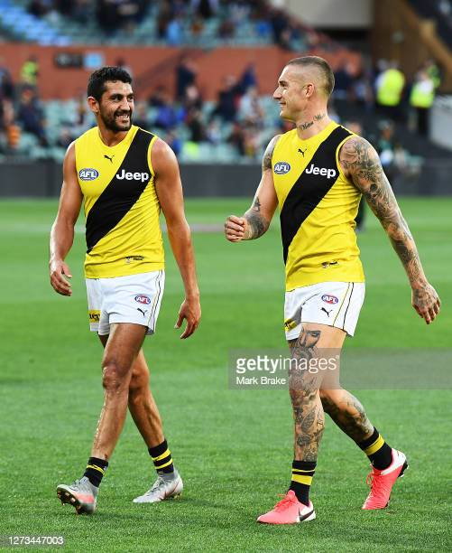 Marlion Pickett of the Tigers and Dustin Martin of the Tigers at half time during the round 18 AFL match between the Adelaide Crows and the Richmond...