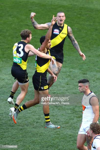 Marlion Pickett of the Tigers and Dustin Martin of the Tigers celebrate during the 2019 AFL Grand Final match between the Richmond Tigers and the...