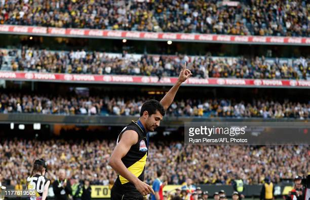 Marlion Pickett of the Tigers celebrates as he is called up to collect his Premiership Medal during the 2019 AFL Grand Final match between the...