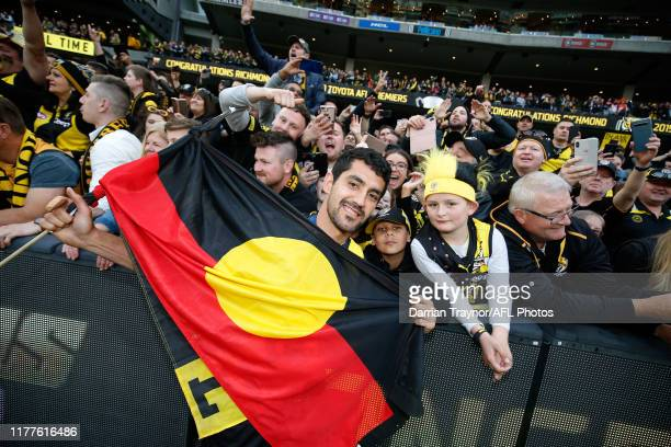 Marlion Pickett of the Tigers celebrates with fans after the 2019 AFL Grand Final match between the Richmond Tigers and the Greater Western Sydney...