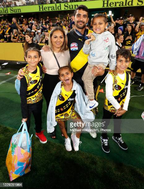 Marlion Pickett of the Tigers celebrates with his family during the 2020 Toyota AFL Grand Final match between the Richmond Tigers and the Geelong...