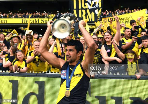 Marlion Pickett of the Tigers celebrates with the Premiership Trophy during the 2019 AFL Grand Final match between the Richmond Tigers and the...