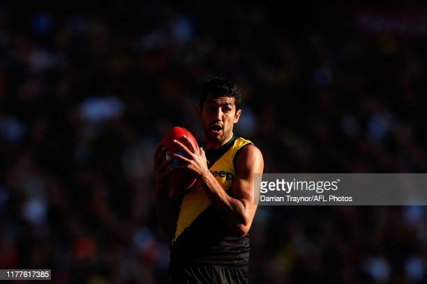Marlion Pickett of the Tigers gathers the ball during the 2019 AFL Grand Final match between the Richmond Tigers and the Greater Western Sydney...