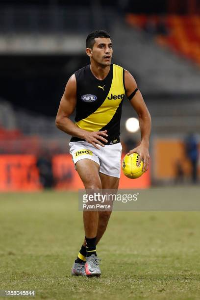 Marlion Pickett of the Tigers kicks during the round 8 AFL match between the Greater Western Sydney Giants and the Richmond Tigers at GIANTS Stadium...