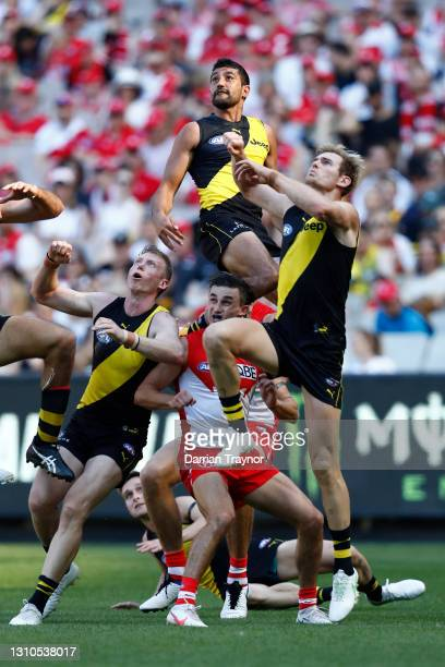 Marlion Pickett of the Tigers leaps early in a marking contest during the round 3 AFL match between the Richmond Tigers and the Sydney Swans at...