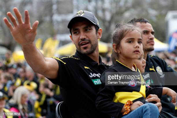 Marlion Pickett of the Tigers waves to fans during the 2019 AFL Grand Final Parade on September 27, 2019 in Melbourne, Australia.
