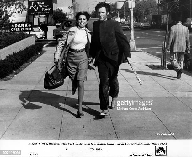 Marlo Thomas and Charles Grodin run through the streets of New York in a scene from the Paramount Pictures movieThieves circa 1977