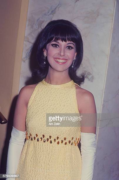 Marlo Thomas in a yellow beaded dress for a formal event circa 1970 New York