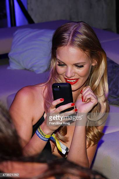 Marloes Horst looks at her smartphone during the Maybelline 100th anniversary celebrations on May 15 2015 in Berlin Germany
