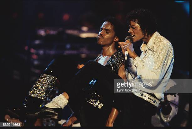 Marlon and Michael Jackson perform at a concert on the Victory tour
