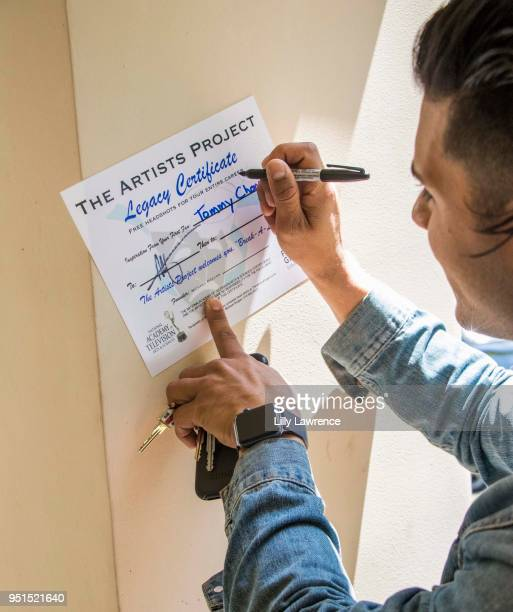 Marlon Aquino poses with Legacy Certificate at Visual Snow Initiative visits The Artists Project on April 25 2018 in Los Angeles California