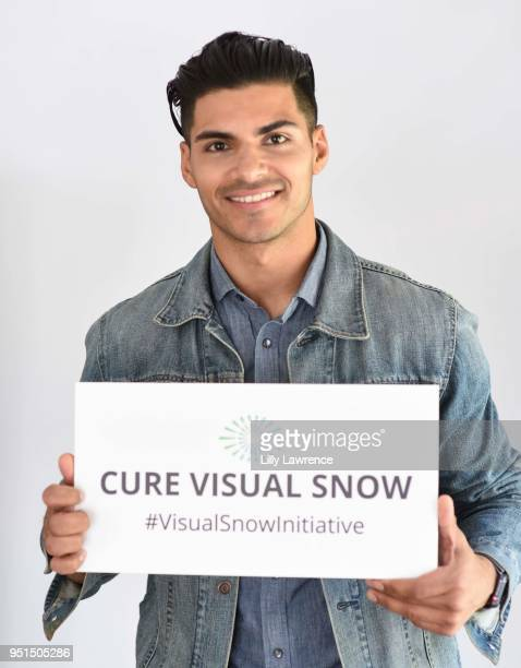 Marlon Aquino poses with Visual Snow Initiative wearing Moonstar Beauty at Visual Snow Initiative visits The Artists Project on April 25 2018 in Los...