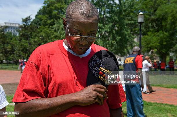 Marlon Askew who works as an administrative support assistant at Veterans Affairs in Temple TX bows his head for a moment of silence for US military...