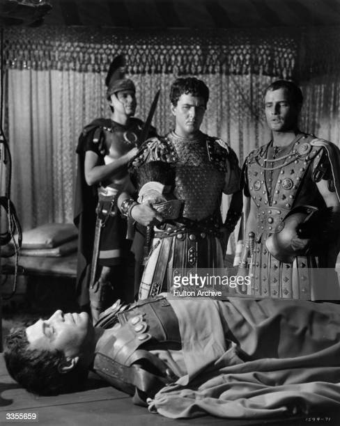 Marlon Brando and Douglass Watson survey the corpse of James Mason in the part of Brutus in the MGM film adaptation of 'Julius Caesar'