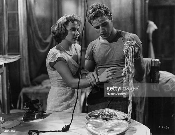 Marlon Brando and Kim Hunter in a dramatic scene from 'A Street Car Named Desire' written by Tennessee Williams and directed by Elia Kazan