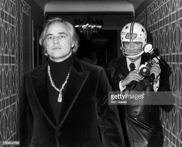 Marlon Brando and photographer Ron Galella during 1st Gala Benefiting the American Indian Development Association at Starlight Room at the Waldorf...