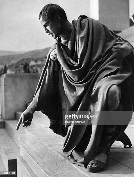 Marlon Brando as Mark Antony is speaking to the Roman crowds at the funeral scene in 'Julius Caesar' directed by Joseph L Mankiewicz for MGM