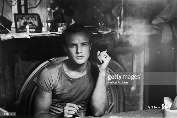 Marlon Brando in a scene from 'A Streetcar Named Desire', adapted from the play by Tennessee Williams and directed by Elia Kazan for Charles K...