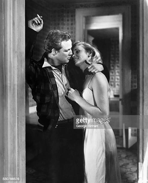 Marlon Brando kisses Eva Marie Saint in a doorway during a scene from the 1954 production of On the Waterfront.