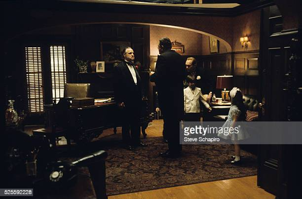 Marlon Brando Lenny Montana and Robert Duvall in a scene from The Godfather