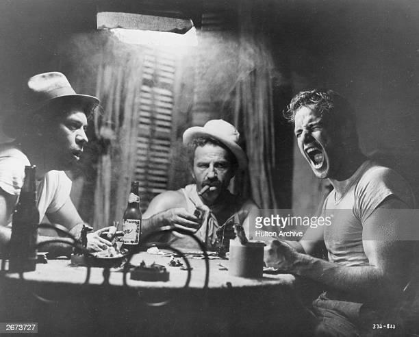 Marlon Brando lets rip in a gambling scene from 'Street Car Named Desire' Original Publication Decades 50's 1215 092