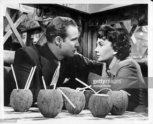 Marlon Brando looks into the eyes of Jean Simmons in a scene from the film 'Guys And Dolls' 1955